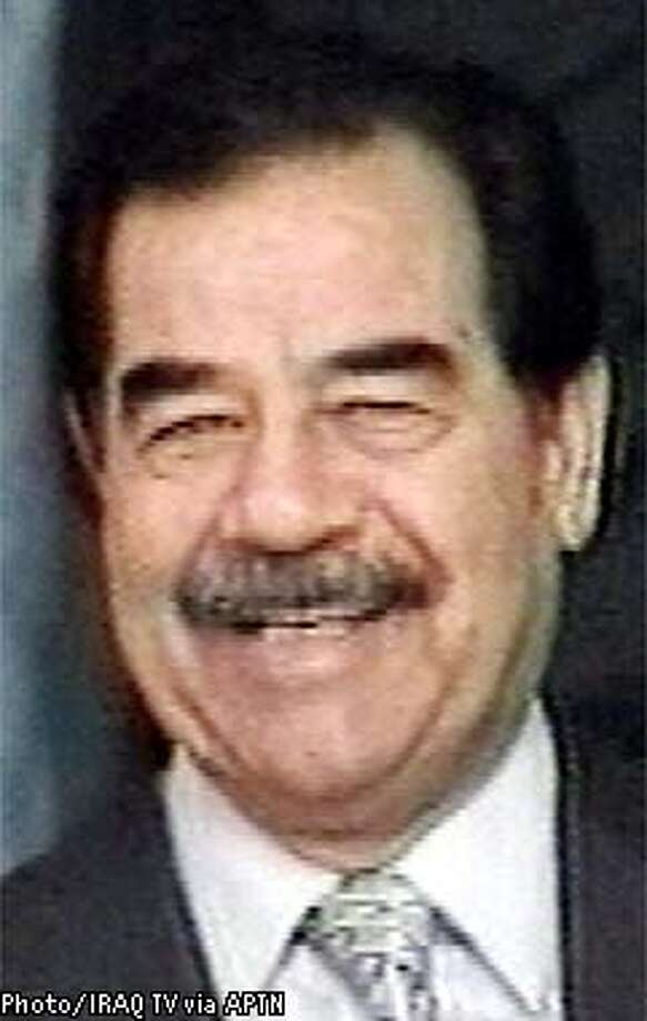 Iraq's President Saddam Hussein attends a meeting of Iraq's Revolutionary Council in Baghdad in this image broadcast by Iraqi television Wednesday, Nov.13, 2002. Saddam Hussein's government told the Iraqi people Wednesday that it would accept U. N. weapons inspectors to prove to the world that Baghdad has no weapons of mass destruction. (AP Photo/IRAQ TV via APTN) ** IRAQ OUT **