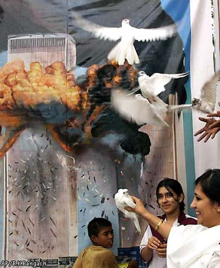 Members of the Pakistani Christian community release doves to wish for peace in the world to commemorate the first anniversary of the terrorist attacks in the United States, Wednesday, Sept. 11, 2002 in Islamabad, Pakistan. (AP Photo/B.K.Bangash) Photo: B.K.BANGASH