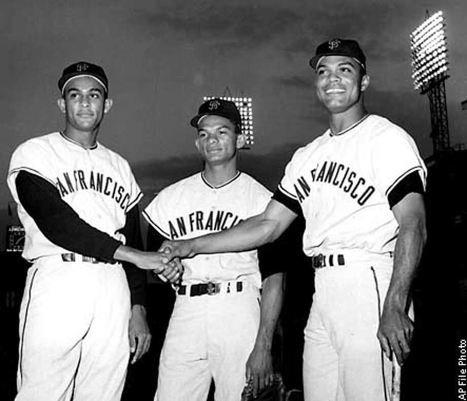 ** FILE ** San Francisco outfielders, from left, Jesus Alou, 21, Matty Alou, 24, and Felipe Alou, 29, of the Dominican Republic, pose before start of game with the New York Mets at New York's Polo Grounds, Sept. 10, 1963. Felipe Alou never envisioned it would happen this way, finishing up his baseball career right back where it all started nearly a half-century ago. Alou was hired Wednesday, Nov. 13, 2002. to manage the National League champion San Francisco Giants, returning to the team he played forin the 1950s and '60s. (AP Photo/File)