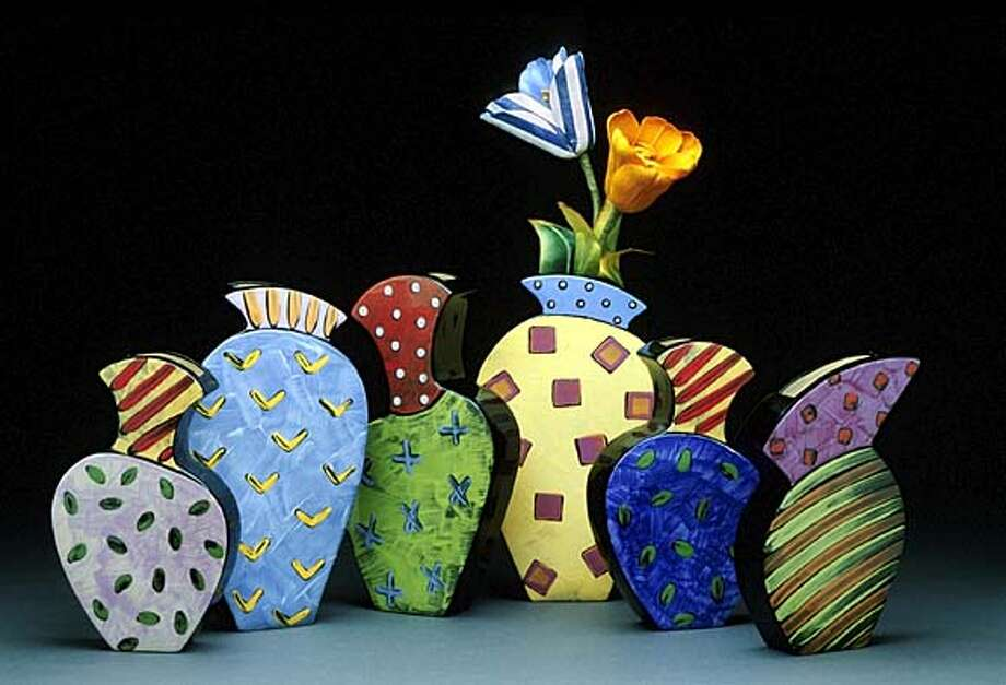 Wall vases by Diana Crain save space like paintings or masks but have quality of sculpture.