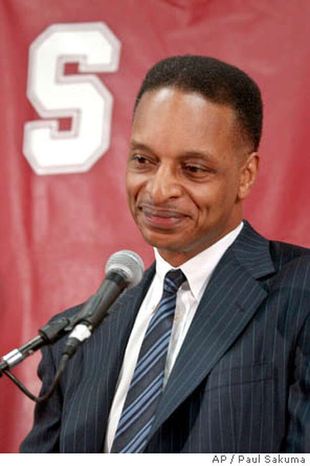 Trent Johnson smiles during a news conference as he is introduced as the new head basketball coach in Stanford, Calif., Tuesday, May 25, 2004. Johnson, 47, a former Cardinal assistant coming off a breakthrough season at Nevada, was hired to replace Mike Montgomery on Tuesday. Montgomery was hired as the head coach at the Golden State Warriors. (AP Photo/Paul Sakuma) Photo: PAUL SAKUMA
