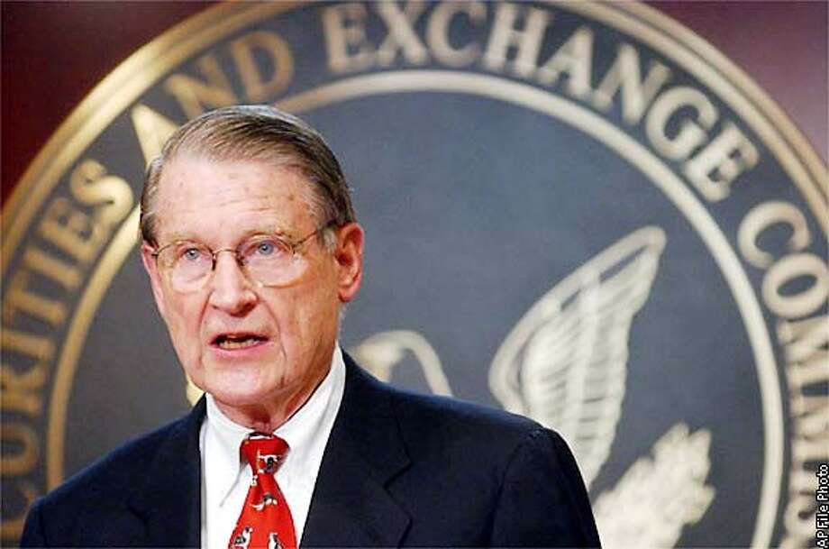 ** FILE ** Former FBI and CIA head William Webster speaks to reporters at the Securities and Exchange Commission building in Washington Friday, Oct. 25, 2002. Webster resigned Tuesday, Nov. 12, 2002, as head of the new accounting industry oversight board. Webster had been named to head the board on Oct. 25. (AP Photo/Lawrence Jackson) Photo: LAWRENCE JACKSON