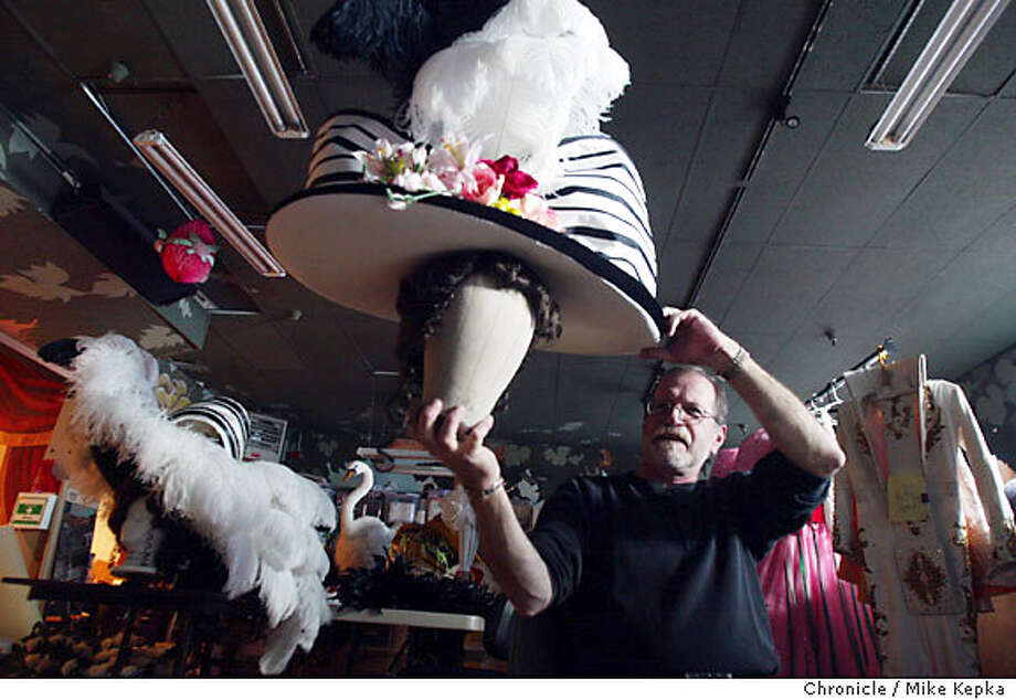 Alan Greenspan, holding his latest creation, the ascot hat, has been a part of the giant hat making process at Beach Blanket Babylon for over 25 years.