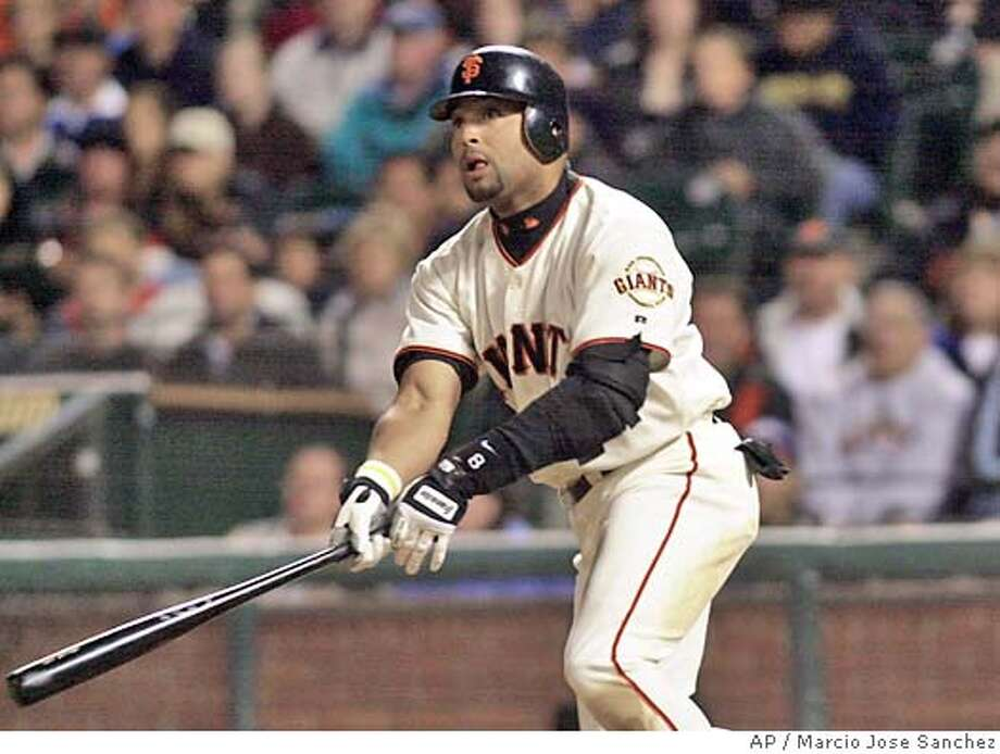 San Francisco Giants' Yorbit Torrealba drives in two runs with double against the Colorado Rockies in the sixth inning on Saturday, May 29, 2004 in San Francisco. (AP Photo/Marcio Jose Sanchez) Photo: MARCIO JOSE SANCHEZ