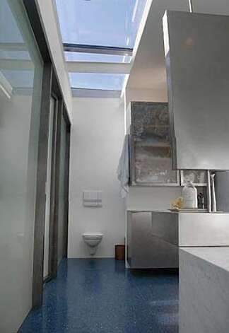 Bathed In Light: The upstairs bathroom in Fourgeron's home has one large skylight for a ceiling.