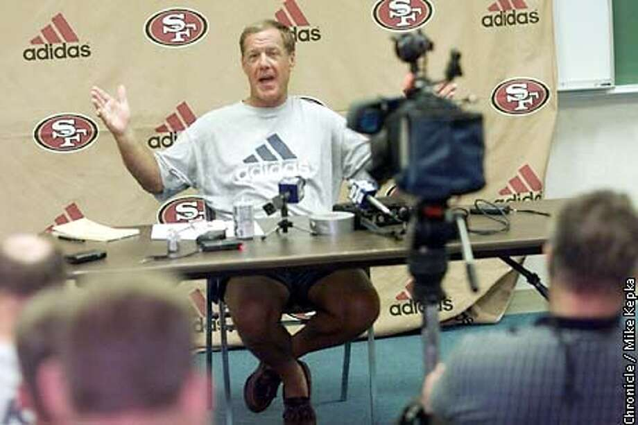 Terry Donahue announces the new contract with QB Jeff Garcia during a press conference at the 49ers training camp in Stockton. BY MIKE KEPKA/THE CHRONICLE Photo: MIKE KEPKA
