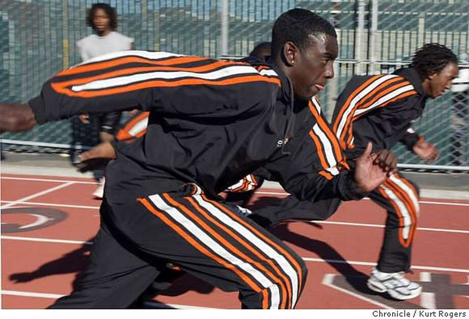 DeSean Watson,Terrance Mccon warm up with some sprints .  McClymonds High track star DeSean Watson, who is a sophomore and runs the anchor leg on McClymonds very fast 400 and 1,600 relay teams. Kurt Rogers/The Chronicle Photo: Kurt Rogers