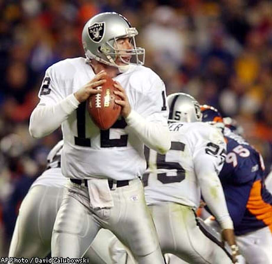 Oakland Raiders quarterback Rich Gannon setup to throw from the pocket during the second quarter against the Denver Broncos on Monday night, Nov. 11, 2002, in Denver. . (AP Photo/David Zalubowski) Photo: DAVID ZALUBOWSKI