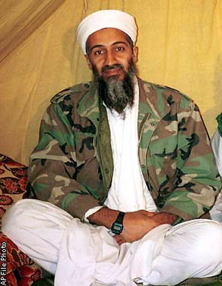 ** FILE ** This is an undated photo of Saudi dissident Osama bin Laden, in Afghanistan. In an audiotaped message aired across the Arab world Tuesday, Nov. 12, 2002, a voice purported to be that of Osama bin Laden praised terrorist strikes in Bali and Moscow and threatened Western nations over any attack on Iraq. (AP Photo, File)