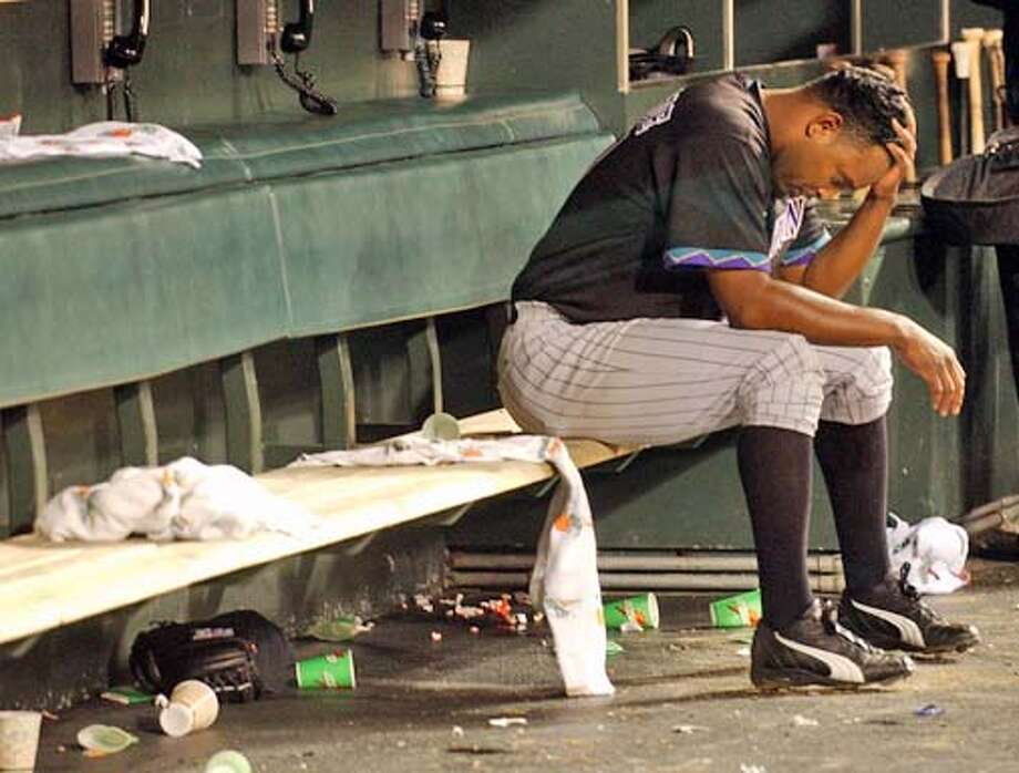 Arizona Diamondbacks' reliever Jose Valverde sits alone in the dugout after giving up the game-winning hit to the San Francisco Giants' Damon Minor on Thursday, May 27, 2004 in San Francisco. The Giants won 5-4. (AP Photo/Marcio Jose Sanchez) Photo: MARCIO JOSE SANCHEZ