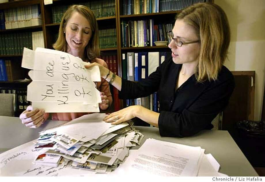 Dr. Lisa Chamberlain(left) and Rachel Ireland (right), a junior resident, going over cigarette cartons having been written with protest messages which will be sent to film studio executives . Shot on 3/10/04 in Palo Alto. LIZ HAFALIA / The Chronicle Photo: LIZ HAFALIA