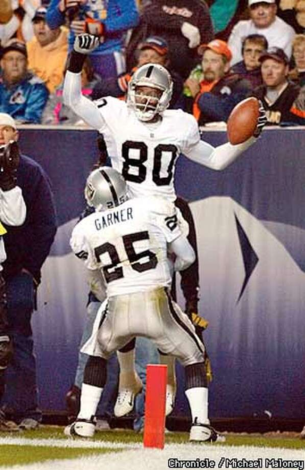 Jerry Rice is hoisted by Rod Woodson after his 200th career TD catch in the 2nd quarter.  Oakland Raiders vs Denver Broncos at Invesco Field in Denver, Colorado.  CHRONICLE PHOTO BY MICHAEL MALONEY Photo: MICHAEL MALONEY