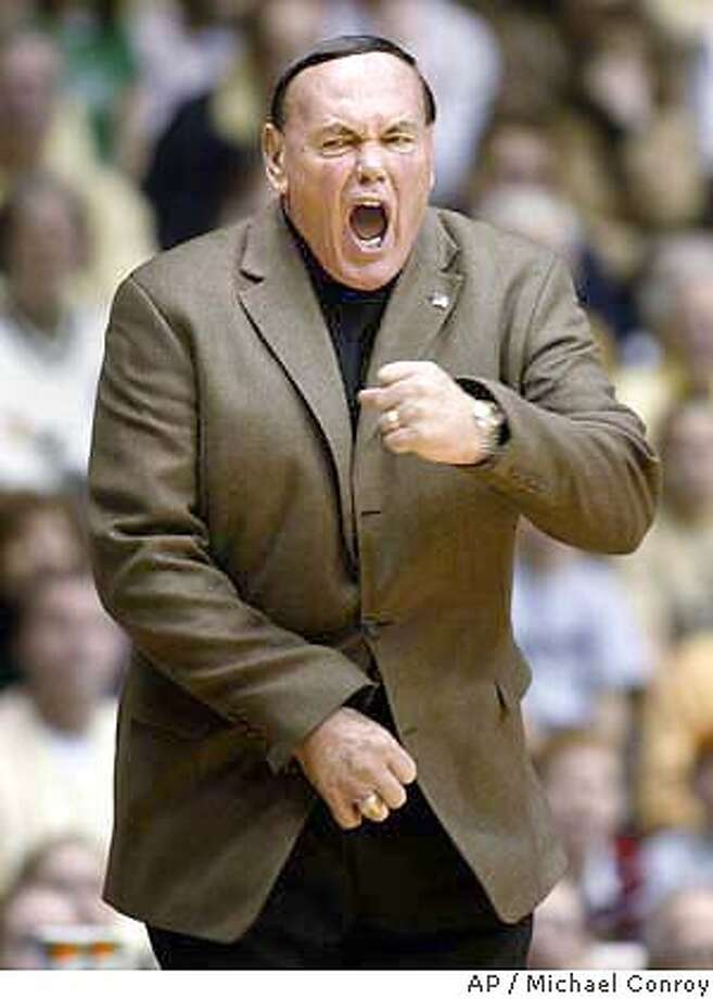 ** FILE ** Purdue coach Gene Keady complains about a call as his team faced Northwestern in West Lafayette, Ind., in this Jan. 11, 2003 photo.Keady could be quitting to take the head coaching job at the University of San Francisco, according to a report by EPSN.com. ESPN.com reported that multiple sources have said that Keady interviewed with University of San Francisco athletic director Bill Hogan on Tuesday on the Dons' campus. ESPN did not identify the sources. Calls seeking comment were left by TheAssociated Press with Hogan and the Purdue Sports Information office Thursday. (AP Photo/Michael Conroy) ProductName	Chronicle A Jan. 11, 2003 file photo Photo: MICHAEL CONROY