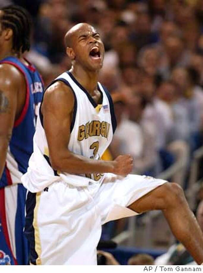 Georgia Tech's Jarrett Jack reacts after hitting a shot late in the second half of their 79-71 overtime win over Kansas in their NCAA St. Louis regional final Sunday, March 28, 2004. (AP Photo/Tom Gannam) Photo: TOM GANNAM