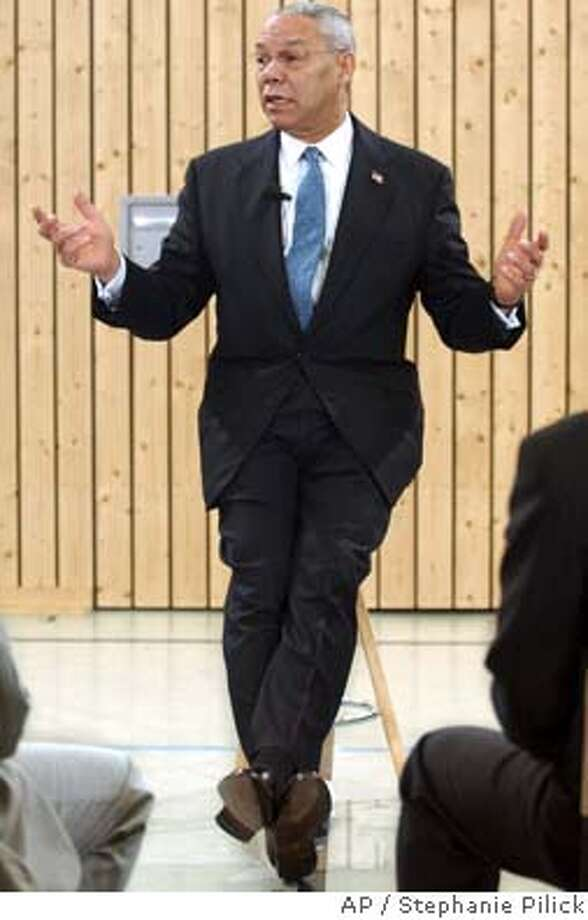 U.S. Secretary of State Colin Powell answers students' question at the Max-Planck High School in Berlin, Thursday April 1, 2004. Powell who is in the German capital for the Afghan donors' conference visited the school to discuss with 70 students items including the Iraq war, Afghanistan and the situation in Middle East. (AP Photo/Stephanie Pilick, Pool) Photo: STEPHANIE PILICK