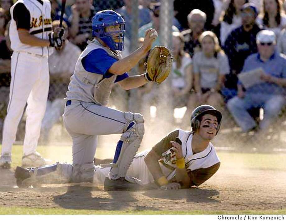 Serra catcher Anthony Stoloski confirms a tag with the umpire after St. Francis' Daniel Descalso unsuccessfully stole home.  St. Francis beats Serra 14-4 in prep baseball. Chronicle photo by Kim Komenich in Mountain View Photo: Kim Komenich