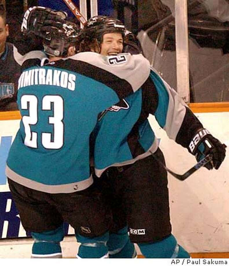 San Jose Sharks right wing Todd Harvey, right, is hugged by right wing Niko Dimitrakos after Harvey scored past the Vancouver Canucks in the first period, Friday, April 2, 2004 in San Jose, Calif. (AP Photo/Paul Sakuma) Photo: PAUL SAKUMA