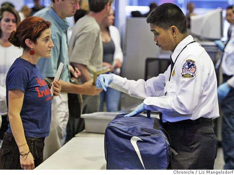 Event on 5/28/04 in San Francisco.  TSA security screener Bernie Vizcaria asks a traveler, who refused to give her name, if he can search her bag at a security checkpoint at SFO United terminal. Security at SFO during the Memorial holiday weekend. Liz Mangelsdorf / The Chronicle Photo: Liz Mangelsdorf