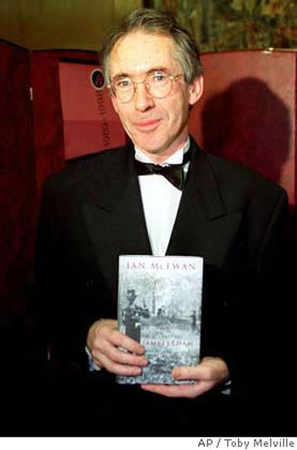 "**FILE**British author Ian McEwan, holds a copy of his book ""Amsterdam"" with which he won the prestigious 1998 Booker Prize after the award was announced at The Guildhall in the City of London, on October 27 1998. (AP Photo/PA,Toby Melville)**UK OUT: MAGS OUT: ** Photo: TOBY MELVILLE"