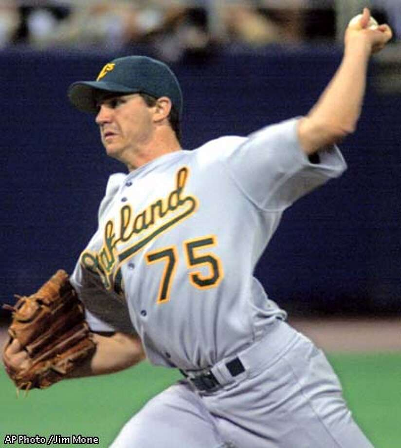 Oakland Athletics' Barry Zito delivers a first inning pitch against the Minnesota Twins Sunday, Sept. 8, 2002, in Minneapolis where Zito was looking for his 20th win. Zito went into the game 19-6. Associated Press photo by Jim Mone Photo: JIM MONE