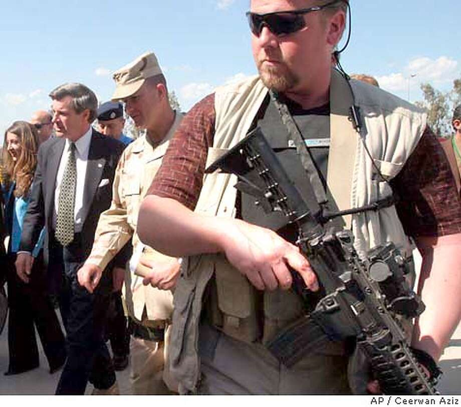 U.S. administrator for Iraq L. Paul Bremer, left, flanked with a bodyguard arrives to attend a meeting Thursday April 1, 2004 in the northern city of Mosul, Iraq. ( AP Photo/Pool, Ceerwan Aziz) Flanked by a bodyguard, U.S. Administrator Paul Bremer (left) arrives to attend a meeting in the northern city of Mosul. Photo: CEERWAN AZIZ