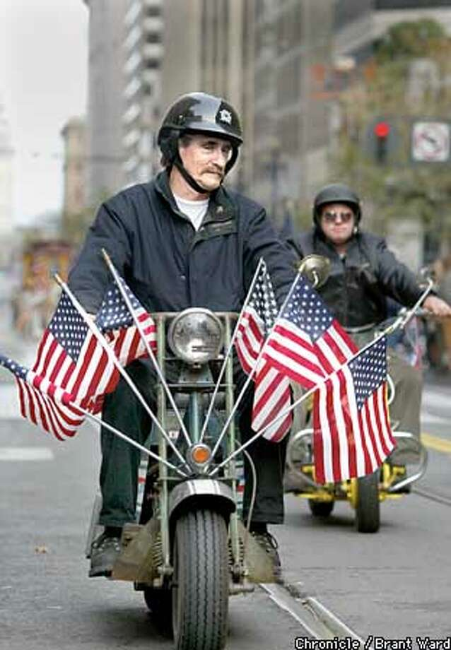 Veteran Jim Jensen from Santa Clara paraded on some old motorcycles in San Francisco's annual Veterans Da pade Sunday. By Brant Ward/Chronicle Photo: BRANT WARD