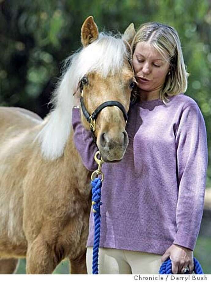 Ulli Sharma of Los Altos holds her pregnant mares she rescued, Allegra, left, and Cassie, right. also Daisy foal she rescued in Los Altos Hills.  Event on 5/11/04 in Portola Valley.  Darryl Bush / The Chronicle Photo: Darryl Bush