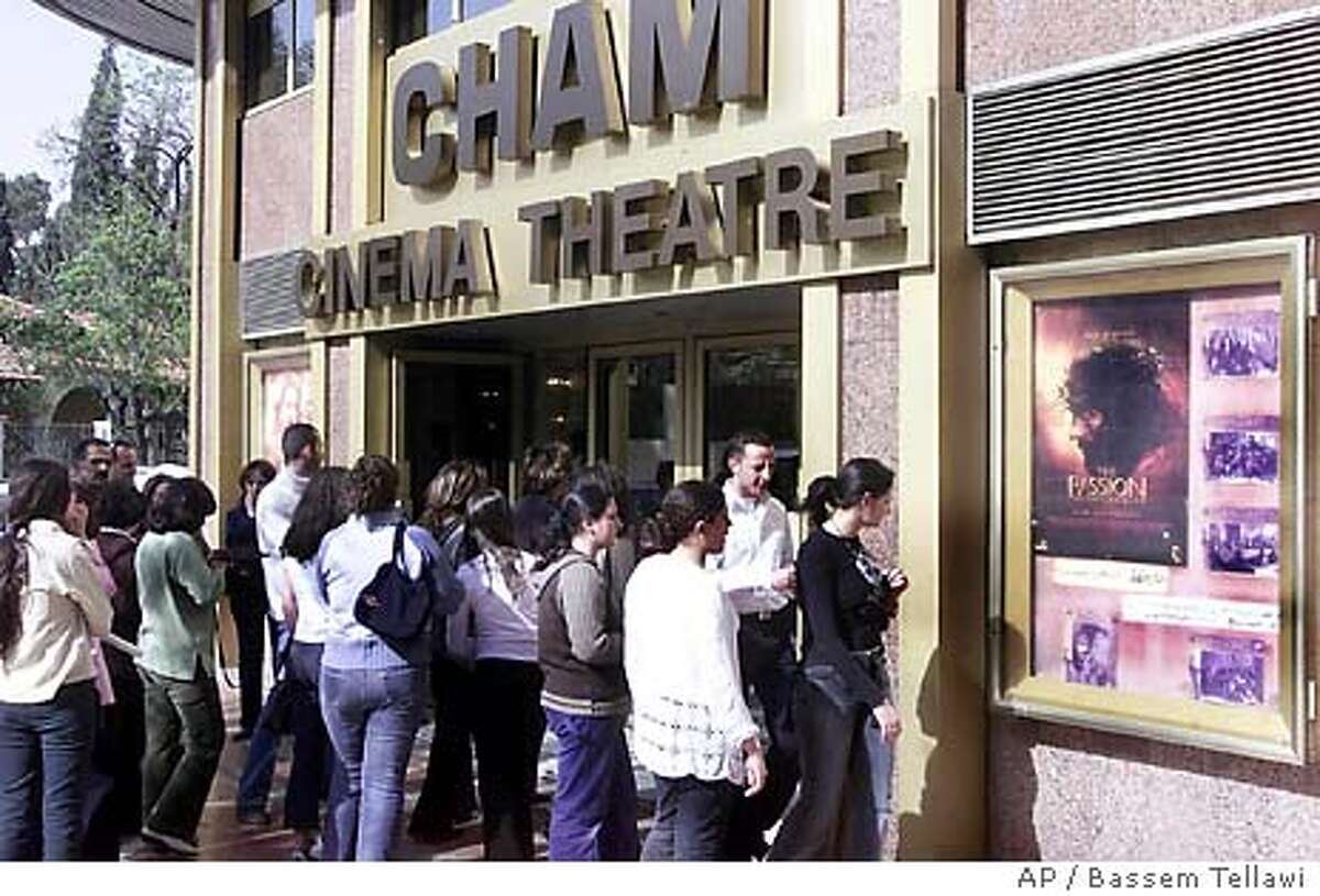 Syrians gather Monday, March 29, 2004 in front of Al-Cham Cinema Theater in Damascus to see the film
