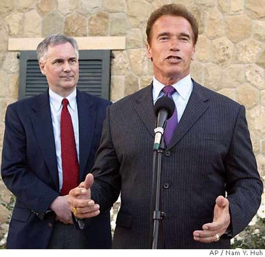 California Gov. Arnold Schwarzenegger, right, and state Sen. Tom McClintock address the media during a fund-raiser for McClintock, Thursday, May, 27, 2004, in Carpinteria, Calif. (AP Photo/Nam Y. Huh) Photo: NAM Y HUH