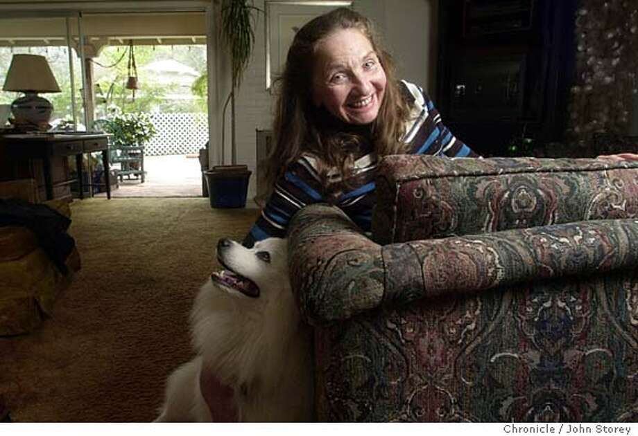Marlene Baldwin with one of her three dogs, Thunder Snow Fox.  X-Madam Marlene Baldwin at her home in San Rafael with her dogs. John Storey/The Chronicle Photo: John Storey