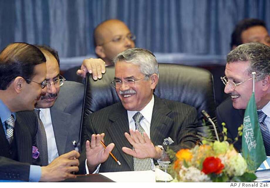 Minister of Petroleum and Mineral Resources Ali Ibrahim Naimi from Saudi Arabia, center, talks with unidentified delegates prior to the start of a meeting of the Organization of the Petroleum Exporting Countries (OPEC) in Vienna, on Wednesday, March 31, 2004 at the OPEC's headquarters in Vienna. (AP Photo/Ronald Zak) Photo: RONALD ZAK