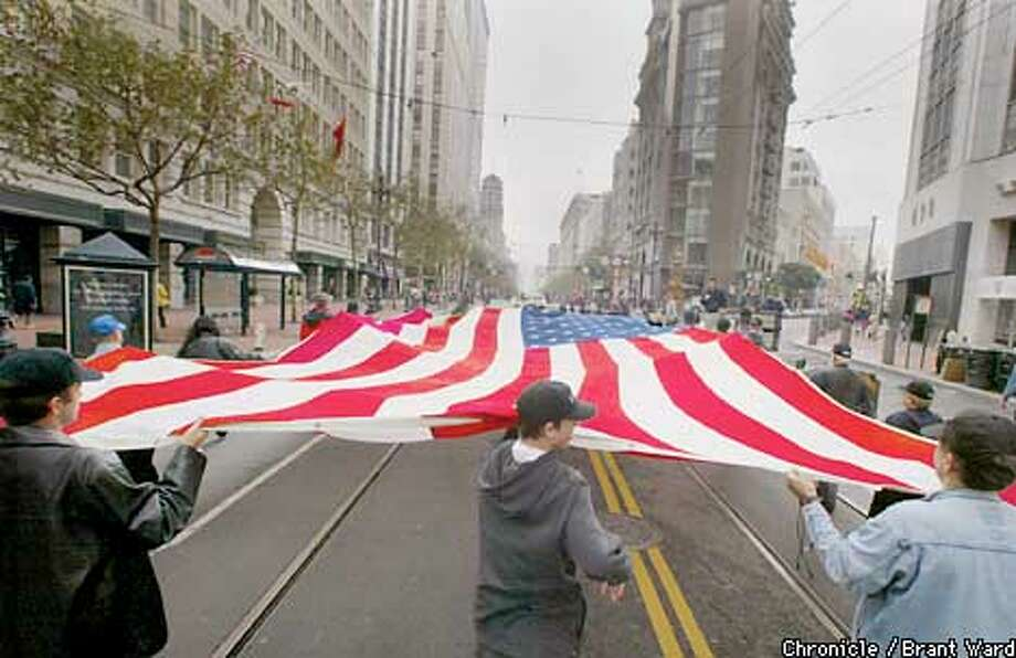 A huge American flag was carried up Market Street Sunday as part of the annual Veteran's Day parade. By Brant WArd/Chronicle Photo: BRANT WARD