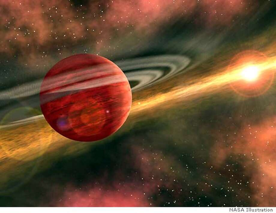 The youngest planet ever detected -- a baby less than one million years old -- may be orbiting a young star in the constellation Taurus, scientists using NASA's Spitzer Space Telescope reported on May 27, 2004. In this artist's conception, the possible newfound planet spins through a clearing in a nearby star's dusty, planet-forming disc. The possible infant planet was spotted circling a star known as CoKu Tau 4, some 420 light-years away, according to astronomer Dan Watson of the University of Rochester, New York. FOR EDITORIAL USE ONLY REUTERS/NASA/Handout Photo: NASA