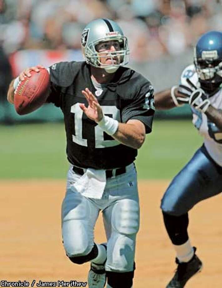 RAIDERS-C-08SEP02-SP-JMM.jpg Raider quarterback #12 Rich Gannon scampers for a 8 yard gain in the first quarter of action. The Oakland Raiders vs. the Seattle Seahawks in Oakland, Ca. September 8, 2002. Carlos Gonzalez/San Francisco Chronicle
