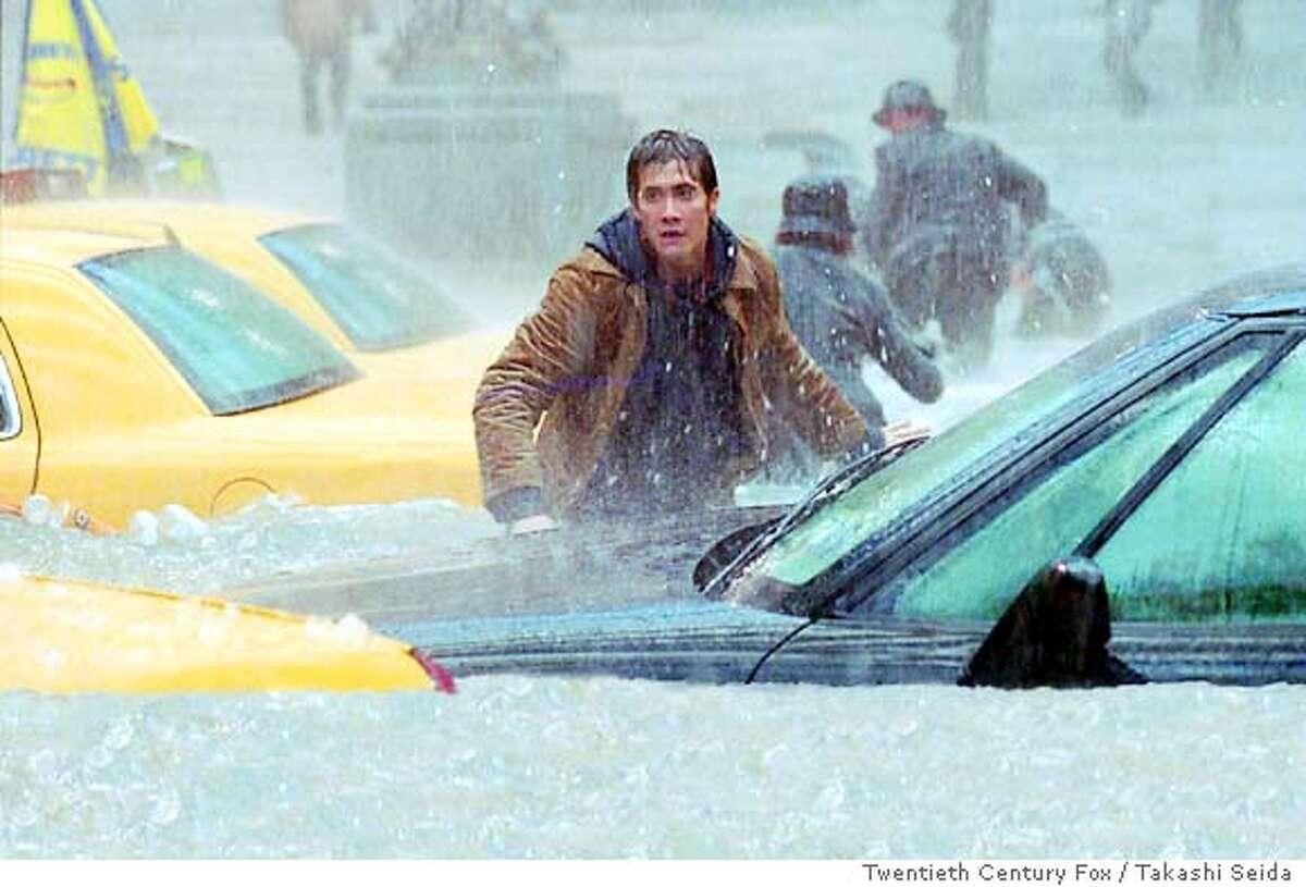 "Amidst a horrific flood, Samuel Hall (Jake Gyllenhaal) searches for his friend in Twentieth Century Fox / Takashi Seida's ""The Day After Tomorrow."" (AP Photo/Takashi Seida)"