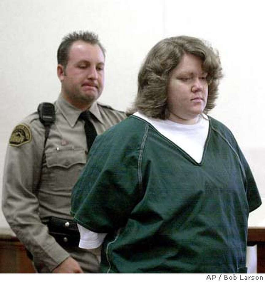 Dawn Godman, 27, is led into court for a preliminary hearing in Martinez, Cailf., Monday Dec. 3, 2001. Godman, Glenn Helzer, 31, his brother, Justin, 29, are accused of going on a killing spree that left five people dead including Selina Bishop, the daughter of blues guitarist Elvin Bishop. (AP Photo/Contra Costa Times, Bob Larson ) CAT Photo: BOB LARSON