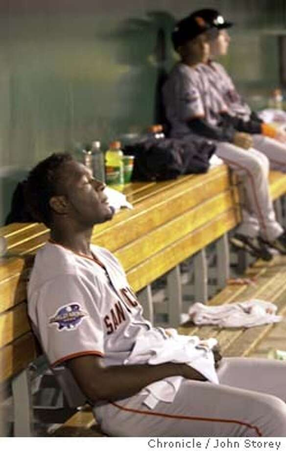 GIANTS71-C-20OCT02-MT-JRS.jpg---Giants pitcher Felix Rodriguez sits in the dugout after the Giants lose to the Angels. The San Francisco Giants play the Anaheim Angels in Game 2 of the World Series at Edison Field in Anaheim, Ca. October 20, 2002. John Storey/San Francisco Chronicle Photo: John Storey