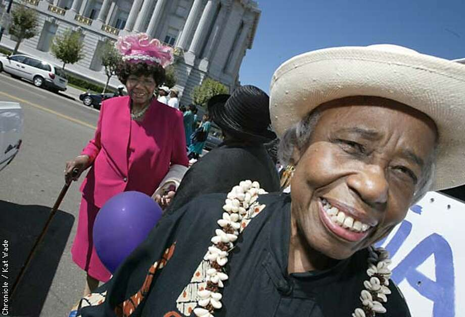 CHURCH09c-C-08SEP02-MT-KW - Vera L. Clanton, the vintage past president of the WMU WOmen's Missionary Union for the Third Baptist Churchand Doris Foster (left) and Carrie Carr rode in the parade and unity celebration for the 150th anniversary of the West Coast's oldest black churches. SAN FRANCISCO CHRONICLE PHOTO BY KAT WADE