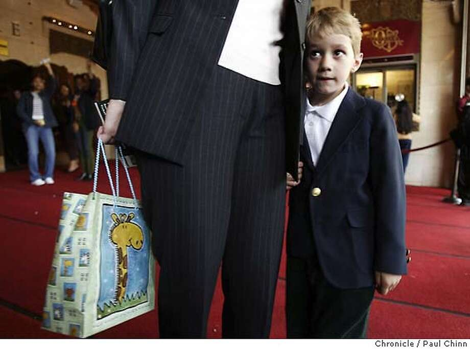 Five-year-old Nicholas Brightbill waits for his grandparents with his mother Dawn in front of the Orpheum on Wednesday. S.F. school kids were treated to a free performance of the Lion King musical at the Orpheum Theater on 3/31/04 in San Francisco. PAUL CHINN/The Chronicle Photo: PAUL CHINN