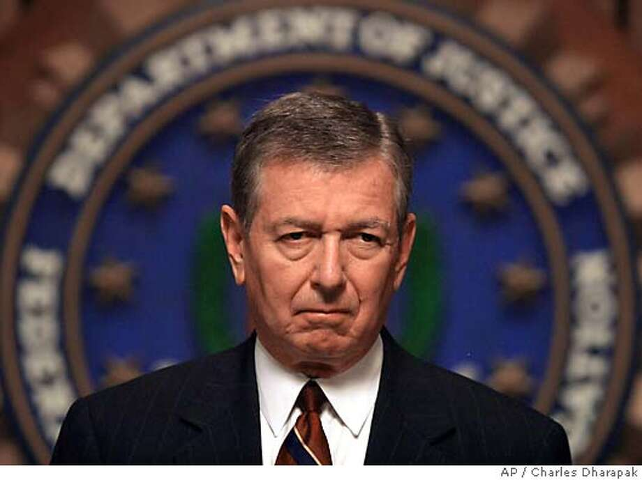 Attorney General John Ashcroft gives a news conference with FBI Director Robert Mueller, not pictured, at FBI Headquarters Wednesday, May 26, 2004 in Washington. (AP Photo/Charles Dharapak) Photo: CHARLES DHARAPAK