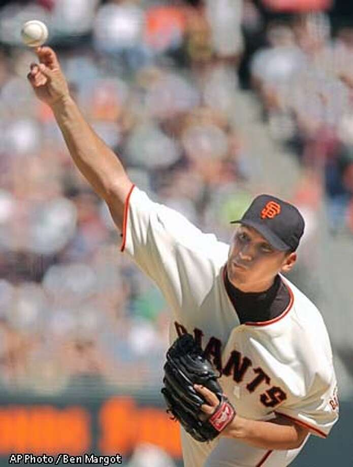 San Francisco Giants' Russ Ortiz delivers against the Arizona Diamondbacks in the second inning Sunday, Sept. 8, 2002, at Pacific Bell Park in San Francisco. (AP Photo/Ben Margot) Photo: BEN MARGOT