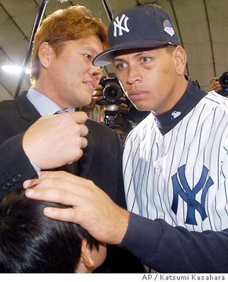 New York Yankees third baseman Alex Rodriguez listens to former Seattle Mariners closer Kazuhiro Sasaki as he puts his hand on the head of Sasaki's son Shogo, 10, during his team's batting practice before the major league season opener between Yankees and the Tampa Bay Devil Rays at Tokyo Dome Tuesday, March 30, 2004. (AP Photo/Katsumi Kasahara) ProductName	Chronicle Photo: KATSUMI KASAHARA