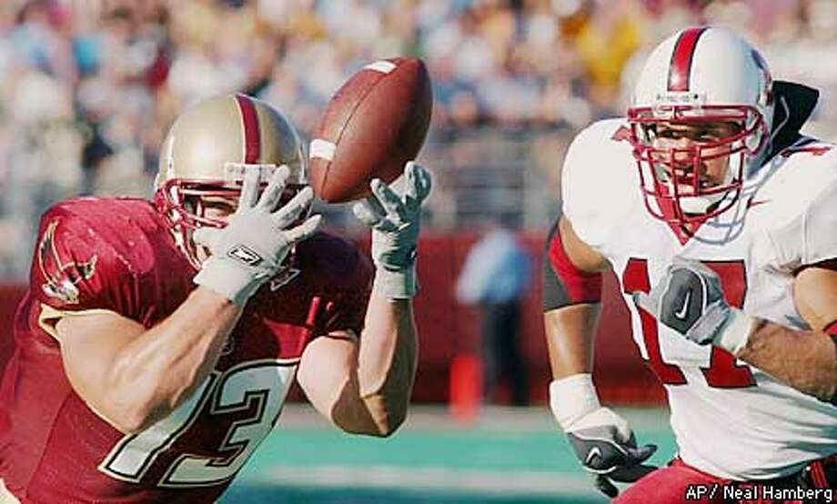 Boston College OT Marc Parenteau (73) bobbles the ball a couple of times but manages to grab hold on Stanford's two-yardline as Stanford MLB Jared Newberry (17) bears down on him late in the first-half of their game at Boston College, Saturday, Sept.7, 2002, setting a B.C. touchdown on the next play. (AP Photo/Neal Hamberg) Photo: NEAL HAMBERG