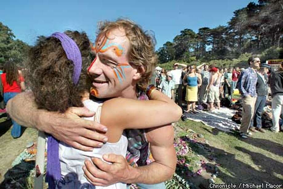 "Steve McKellips of Sacramento was giving out hugs to everyone, here he hugs Nicole Buffett of SF. 4th Annual ""911 Power to The Peaceful Festival"", takes place at Speedway Meadow in Golden Gate Park. by Michael Macor/The Chronicle Photo: MICHAEL MACOR"
