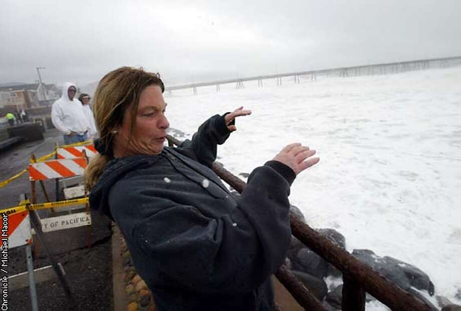Kelly Kirwin came from Concord to get sprayed by the high waves crashing into the seawall along the end of Pacifica. by Michael Macor/The Chronicle Photo: MICHAEL MACOR