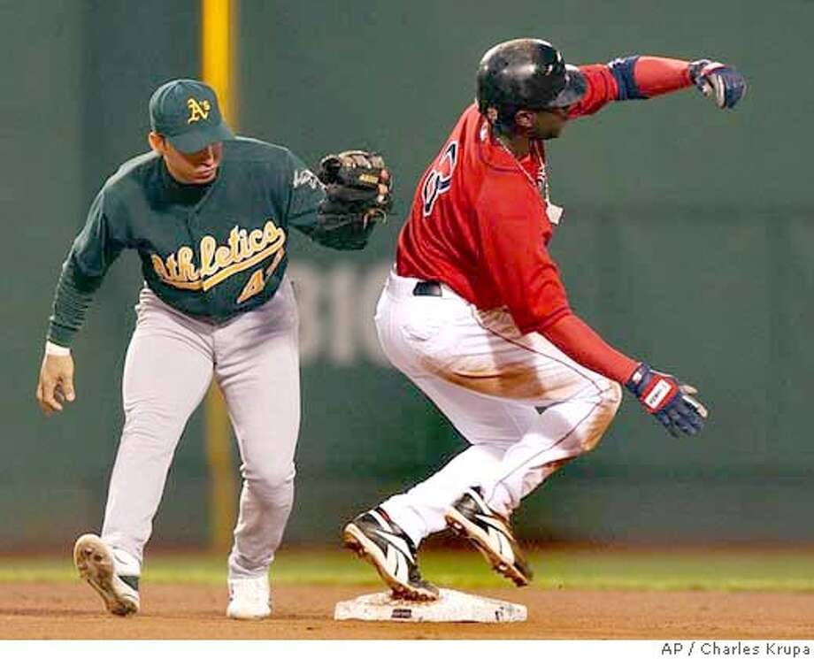 Boston Red Sox's Pokey Reese, right, safely steals second base ahead of a tag by Oakland Athletics second baseman Marco Scutaro during the third inning at Fenway Park in Boston, Wednesday May 26, 2004. (AP Photo/Charles Krupa) Photo: CHARLES KRUPA