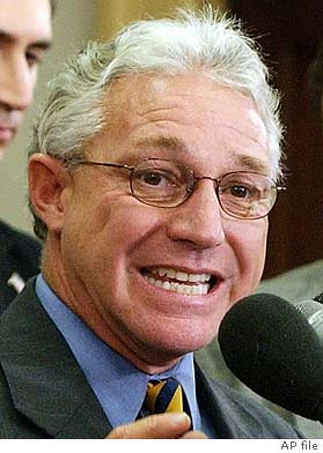 Representative James Greenwood, R-Pa., center, chairman of the House Energy and Commerce Oversight and Investigations Subcommittee and full committee Chairman Rep. Billy Tauzin, R-La., left, asked the Justice Department Tuesday, Sept. 10, 2002, to begin criminal investigation into whether Martha Stewart knowingly lied to the committee about the sale of her Imclone stock. Also appearing at a Capitol Hill news conference in the background are committee investigator Alan Slobodin, center, and Ken Johnson, right, a member of Tauzin's staff. (AP Photo/Dennis Cook)  ALSO RAN 12/09/02, 01/14/03, 01/31/03, 04/29/03 CAT muglet of guy on far right; call me if it's too soft to work Rep. Billy Tauzin said a compromise spam bill would &quo;bring peace of mind back'' to e-mail users. Rep. James Greenwood Photo: DENNIS COOK