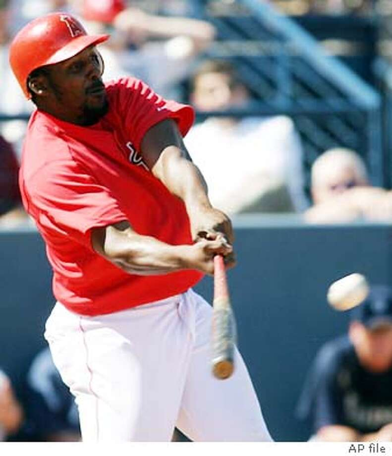 Anaheim Angels Vladimir Guerrero hits a triple off the center field wall, during the third inning of their Cactus League game against the Seattle Mariners, Wednesday, March 10, 2004, in Tempe, Ariz.(AP Photo/Roy Dabner) ProductName	Chronicle Photo: ROY DABNER