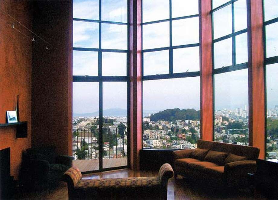 These are before and after photos for a house in Twin Peaks, where architect Doug Thompson turned the wall with 3 and 4 foot windows into a wall of glass, looking out over the city.