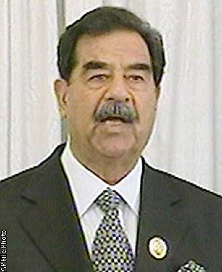 Iraqi president Saddam Hussein makes a television address broadcast to his nation Thursday Aug. 8 2002 in which he declared any war against Iraq was doomed to failure and that any attack will have dire consequences for aggressors. Dialogue was the way forward, he said. Iraq would defend its territory if necessary, but the Iraqi people were ready to listen to any call for peace. The address comes as speculation continues into possible US military action against Iraq. (AP Photo/Iraqi TV via APTN) ** TV OUT **